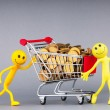 Smilies with shopping carts and coins - Stok fotoraf