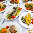 Постер, плакат: Lots of meals served on table