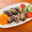 Baked potatoes in the plate - Stock Photo