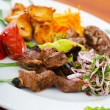 Plate with tasty lamp kebabs - Stock Photo