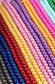 Abstract met kleurrijke parel kettingen — Stockfoto