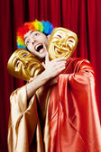 Actor with maks in a funny theater concept — Stock Photo