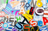 Newspaper clippings with various letters — Stock Photo
