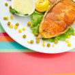 Roasted salmon in the plate — Stock Photo
