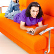 Student working with laptop sitting on sofa — Foto Stock