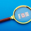 Foto Stock: Unemployment concept with magnifying glass