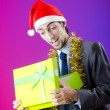 Businessman offering gifts on christmas — Stock Photo #7312501