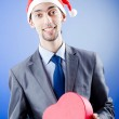 Businessman offering gifts on christmas — Stock Photo #7312527