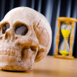 Concept of death with hourglass and skull — Stock Photo