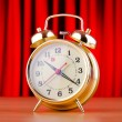 Alarm clock against curtain — Stockfoto