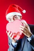 Noel hediyeler sunan iş adamı — Stok fotoğraf