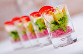 Vegetarian salad served in glasses — Stock Photo