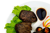 Steak with sauce in the plate — Stock Photo