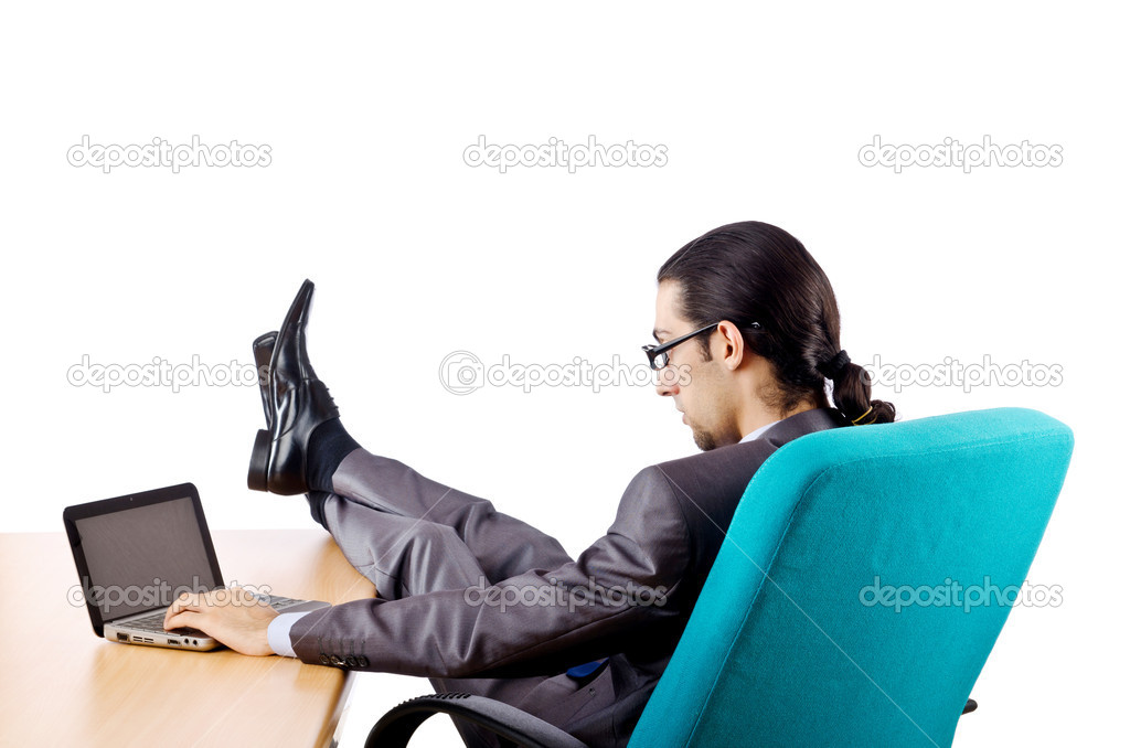 Businessman sitting at the desk — Stock Photo #7314485