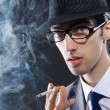 Young man smoking cigarette - Stock fotografie