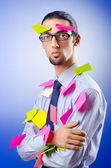 Young businessman with reminder notes — Stock Photo