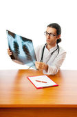 Male doctor looking at x-ray image — Stock Photo