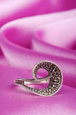 Jewellery ring on the satin background — Stockfoto