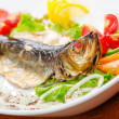Fried fish in the plate — Stock Photo #7375685