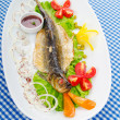 Fried fish in the plate — Stock Photo #7375689