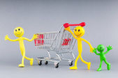 Shopping cart and happy smilies — Stock Photo