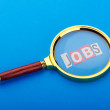 Unemployment concept with magnifying glass — Stok fotoğraf