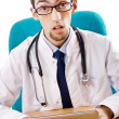 Male doctor working on laptop — Stock Photo #7382772