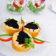 Black caviar in the plate — Stock Photo