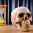 Concept of death with hourglass and skull — Stock Photo #7384337