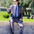 Young businessman at the street scene — Stock Photo