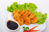 Breaded chicken pieces served with sauce — Stock Photo