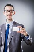 Businessman holding blank message — Stock Photo