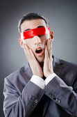 Businessman blinded by red tape — Stockfoto