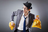 Businessman with sacks of presents — Stock Photo