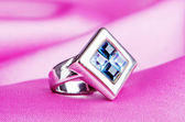 Jewellery ring on the satin background — Stok fotoğraf