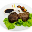 Steak with sauce in the plate - Stock Photo
