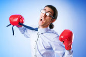 Businessman with boxing gloves — Zdjęcie stockowe