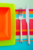 Empty plate with utensils — Stock Photo