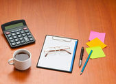 Desk top with many items — Stock Photo