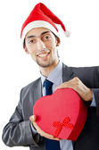 Office worker offering giftbox on white — Stock Photo
