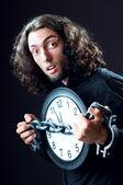 Czas koncepcja człowieka i zegar — Zdjęcie stockowe
