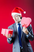 Businessman offering gifts on christmas — Stock fotografie