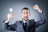 Businessman awarded with star award — Stock Photo