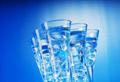 Water in the glass against gradient background — Stock Photo