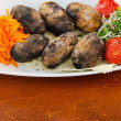 Baked potatoes in the plate — Stock Photo