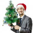 Businessman with christmas tree on white — Stock Photo