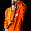 Stock Photo: Inmate chained on black background