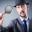 Detective and magnifying glass — Stock Photo #7521131