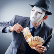 Businessman with money and mask — Stock Photo #7521400