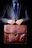 Business spy with briefcase — Stock Photo